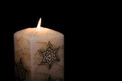 Vela ardiente de la Navidad Imagen de archivo libre de regalías