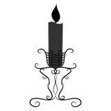 Vela blanco y negro del vintage con una vela ardiente Foto de archivo libre de regalías