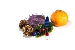 Vela com um tangerine Imagem de Stock
