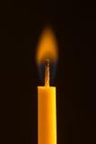 Vela con la llama anaranjada Imagen de archivo libre de regalías