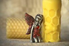 Vela da cera de abelha e uma fada Imagem de Stock