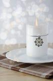 Vela de la Navidad con el copo de nieve Imagen de archivo