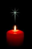 Vela de la Navidad con la cruz Imagenes de archivo