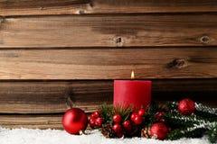 Vela de la Navidad con las ramas del abeto Imagen de archivo libre de regalías