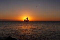 Vela de la puesta del sol Foto de archivo libre de regalías