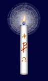 Vela de Pascua con el monograma de Cristo Imagenes de archivo