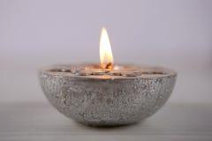 Vela de plata con el copo de nieve Imagen de archivo libre de regalías