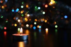 vela del Año Nuevo en fondo borroso Imagenes de archivo