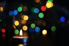 vela del Año Nuevo en fondo borroso Fotos de archivo libres de regalías