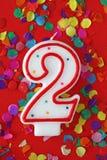 Vela del cumpleaños del dos de número Imágenes de archivo libres de regalías