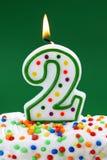 Vela del cumpleaños del dos de número Foto de archivo libre de regalías