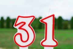Vela do aniversário na forma do número 31 fotos de stock royalty free