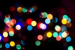 Vela do Natal e decorações dos presentes no fundo do feriado de Blured Imagem de Stock