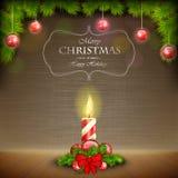 Vela do Natal no fundo riscado Imagens de Stock Royalty Free