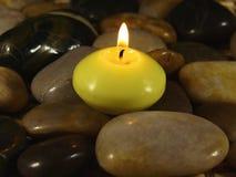 Vela en piedras Imagen de archivo libre de regalías