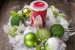 Vela grande del Año Nuevo y guirnalda festiva Foto de archivo libre de regalías