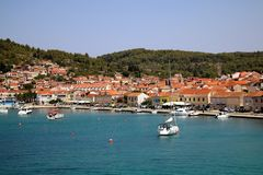Vela Luka, Croatia. August 6, 2017: Traditional Mediterranean architecture, sailboats and fishing boats in port of Vela Luka, small town on island Korcula royalty free stock photo