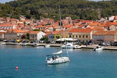 Vela Luka, Croatia. August 6, 2017: Traditional Mediterranean architecture, sailboats and fishing boats in port of Vela Luka, small town on island Korcula stock photography