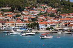 Vela Luka, Croatia. August 6, 2017: Traditional Mediterranean architecture, sailboats and fishing boats in port of Vela Luka, small town on island Korcula royalty free stock photography
