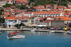 Vela Luka, Croatia. August 6, 2017: Traditional Mediterranean architecture, sailboats and fishing boats in port of Vela Luka, small town on island Korcula stock image