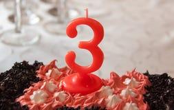 Vela no bolo de aniversário Foto de Stock Royalty Free