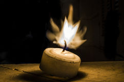 Vela no fogo Fotografia de Stock Royalty Free