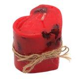 Vela roja bajo la forma de corazón. Hecho a mano. foto de archivo libre de regalías