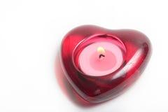 Vela roja del corazón con la llama Imagen de archivo