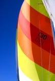 Vela variopinta su una barca a vela Fotografia Stock Libera da Diritti