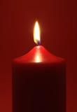 Vela vermelha flamejante Fotografia de Stock Royalty Free