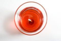 Vela vermelha no vidro Imagem de Stock