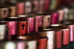 Velas alinhadas em Christian Monastery foto de stock royalty free