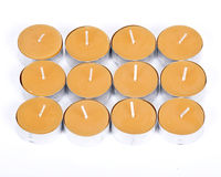 12 velas amarelas Fotos de Stock