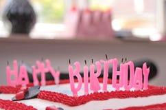 Velas apagadas en una torta de cumpleaños Imagen de archivo libre de regalías