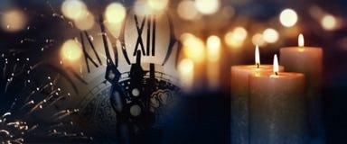 Velas ardientes al final del año Imagen de archivo libre de regalías