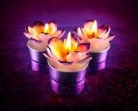 Velas ardientes de la flor Imagen de archivo libre de regalías