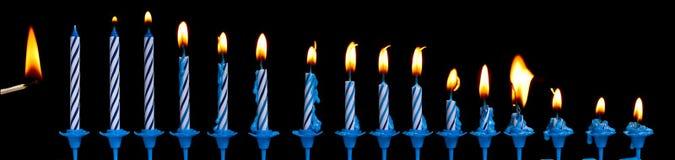 Velas ardientes del cumpleaños Imagen de archivo libre de regalías