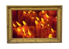 Velas ardientes en el marco Fotografía de archivo