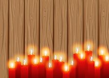 Velas ardientes en un fondo de madera cosiness stock de ilustración
