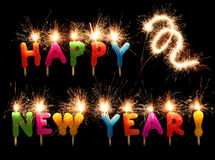 Velas chispeantes festivas de la Feliz Año Nuevo Imagenes de archivo