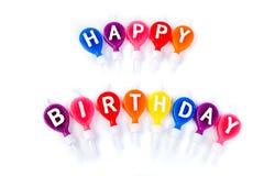 Velas coloridas de feliz cumpleaños Foto de archivo libre de regalías