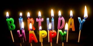 Velas coloridas del cumpleaños encendidas Imagen de archivo