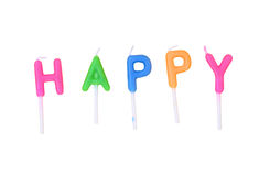 Velas coloridas en las letras - feliz aisladas en el fondo blanco (trayectoria de recortes) Fotos de archivo
