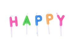 Velas coloridas nas letras - feliz isoladas no fundo branco (trajeto de grampeamento) Fotografia de Stock