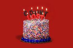 Velas da celebração do aniversário no fundo vermelho Imagem de Stock Royalty Free