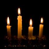 Velas de la luz de una vela Foto de archivo