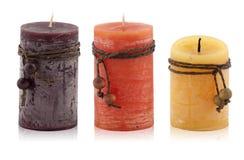 Velas decorativas en un fondo blanco Imagen de archivo libre de regalías