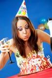 Velas del cumpleaños de la mujer que soplan Fotografía de archivo libre de regalías