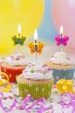 Velas del cumpleaños de las mariposas Fotografía de archivo libre de regalías