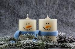 Velas del muñeco de nieve Fotografía de archivo